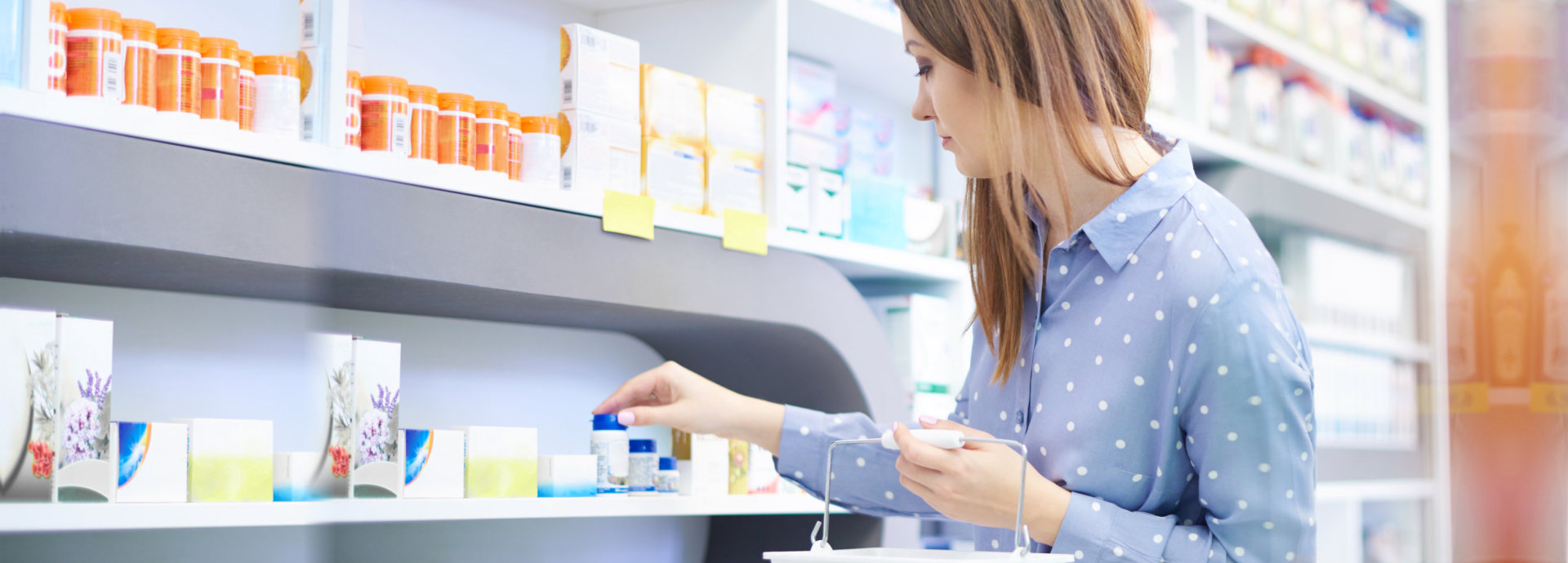 a pharmacist helping a lady